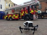 Drone helps firefighters in teenagers' rooftop rescue
